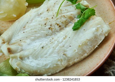 Lutefisk,  traditional dish of some Nordic countries, Norwegian  cuisine,  Traditional assorted dishes, Top view.