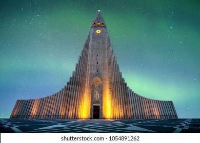 Hallgrímskirkja is a Lutheran (Church of Iceland) church in Reykjavík.It is the largest church in Iceland and the tallest structures in Iceland.There is an colorful aurora borealis in baackground