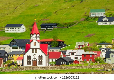 Lutheran Church With Red Roof in Sandavagur village, Located On The Faroe Islands, Denmark