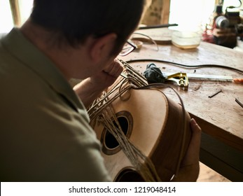 Luthier Install Binding on an guitar.