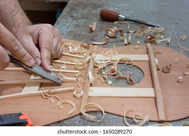 Luthier making top of guitar