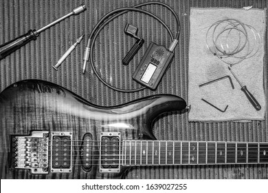 Luthier workbench with tools and an eletric guitar - black and white