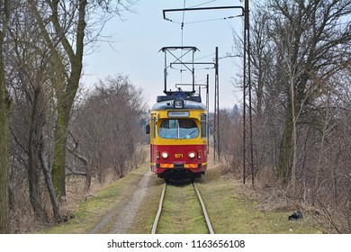 LUTOMIERSK, POLAND - MARCH 24, 2018 - Suburban tramway line 43B, served by an old GT6 tram, operated by MPK-Lodz, linking Lutomiersk and Lodz