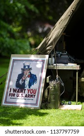Luton, UK May 26 2011 : Army Recruitment sign and radio communications equipment with a green canvas tent and other objects at Wrest Parks St Georges Day