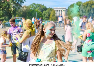 Lutsk/ Ukraine - August 2018: Bunch of colorful hands of friends group having fun at beach party on holi color festival summer vacation - Youth friendship concept with multicolored powder game