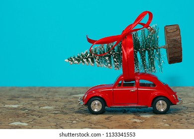 Lutsk, Ukraine, December 17, 2017.Miniature car with a Christmas tree on a blue background. Holiday Christmas.