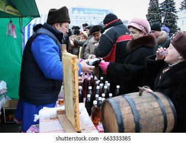 LUTSK, UKRAINE - January 11, 2009: Men sell wine at traditional Christmas market on Teatralna Square