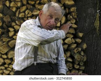 LUTSK, UKRAINE - JULY 13 - An unidentified elderly man sitting at outdoor in Lutsk on July 13, 2005.