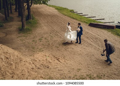 Lutsk, Ukraine, May 18, 2018: Wedding Videographer with Bride
