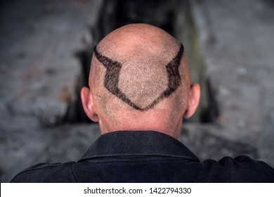 Lutsk. Ukraine October 19, 2018; Skinhead. Shaved hair on the head in the form of a pattern. Dark thinking mind in a simple design. Aggressive characters.