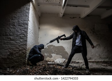 Lutsk. Ukraine. October 19, 2018; A man with a weapon threatens a hostage who is in the basement.