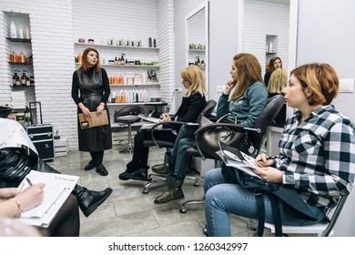 Lutsk, Volyn / Ukraine - December 06 2017: Speaker at workshop and presentation for hairdressers in saloon.