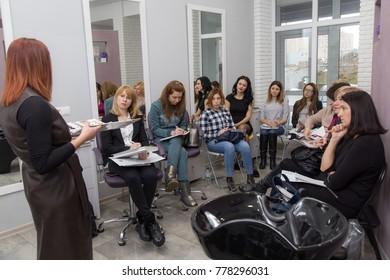 Lutsk, Volyn / Ukraine - December 06 2017: Speaker at workshop and presentation for hairdressers in salon.