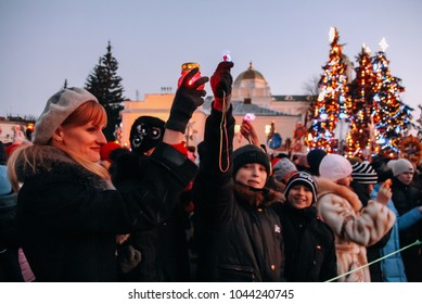 Lutsk, Volyn / Ukraine - January 11, 2009: Participants with flashlights on the mass holiday festivities in the center of the city during the celebration of Orthodox Christmas.