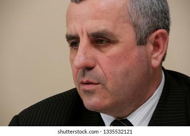 Lutsk, Volyn / Ukraine - March 30 2009: Side profile of a businessman in office