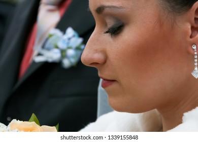 Lutsk, Volyn / Ukraine - November 14 2009: Profile view of bride on street