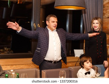 Lutsk, Volyn / Ukraine - November 17 2017: Man standing and stretching his arms in restaurant