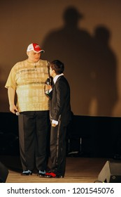 Lutsk, Volyn / Ukraine - November 24 2009: Big and small men standing face to face on the stage of the theater