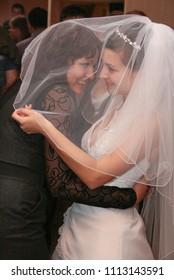 Lutsk, Volyn / UKRAINE - October 12 2008: Bridesmaid dance in the bride's veil at restaurant
