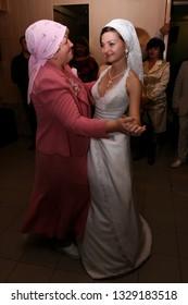 Lutsk, Volyn / Ukraine - October 12 2008: Mother and happy bride on their wedding