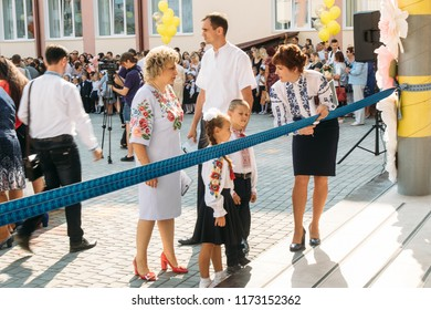Lutsk, Volyn / Ukraine - September 01 2018: The administration cuts the ribbon during the ceremony of opening the new school
