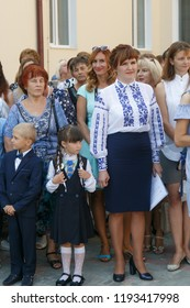 Lutsk, Volyn / Ukraine - September 01 2018: The pupil and parents during the ceremony of opening the new school