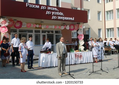 Lutsk, Volyn / Ukraine - September 01 2018: The administration and pupil during the ceremony of opening the new school