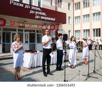 Lutsk, Volyn / Ukraine - September 01 2018: The administration and pupil singing national country anthem during the ceremony of opening the new school