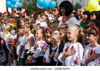 Lutsk, Volyn / Ukraine - September 01 2018: The pupil singing national country anthem during the ceremony of opening the new school