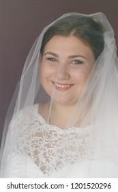 Lutsk, Volyn / Ukraine - September 16 2018: Girl is in a wedding decoration at home