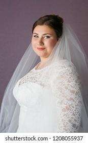 Lutsk, Volyn / Ukraine - September 16 2018: Plus size bride posing at home