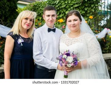 Lutsk, Volyn / Ukraine - September 16 2018: Groom and bride with mother