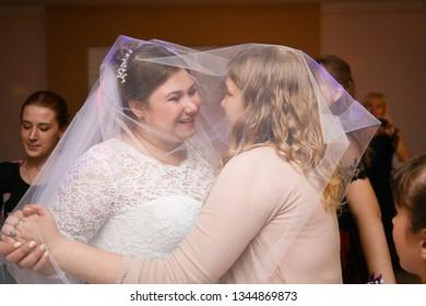 Lutsk, Volyn / UKRAINE - September 16 2018: Bridesmaid dance under the bride's veil at restaurant
