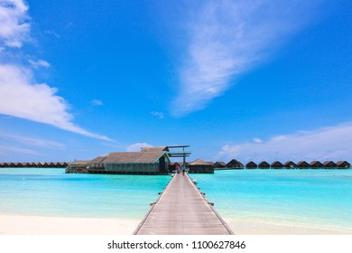 LUX SOUTH ARI ATOLL 2014, the entrance bridge of 5 star luxury resort in Maldives with a restaurant and water villa facade under the clear sky on September 2014