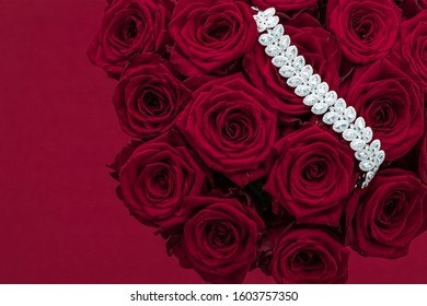 Luxe branding, glamour fashion and boutique shopping concept - Luxury diamond jewelry bracelet and red roses flowers, love gift on Valentines Day and jewellery brand holiday background design