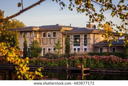 Luxe villa seen through trees stock photo edit now