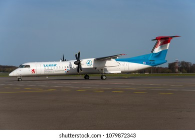 LUXEMBOURG / LUXEMBOURG - APRIL 2018 Luxair De Havilland Canada DHC-8-402Q Dash 8, LX-LGE, cn 4284 taxing to the Terminal. Wearing sticker promoting the financial location Luxembourg.