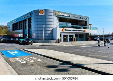 Luxembourg - April 4, 2016: Building on the border of Luxembourg and France.   McDonald's restaurant, Starbucks Coffee and Shell logos. Western Europe