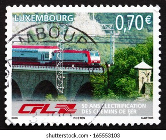 LUXEMBOURG - CIRCA 2006: a stamp printed in the Luxembourg shows Train on Bridge, Electrification of Railway Network, 50th Anniversary, circa 2006