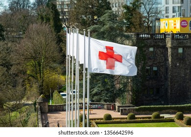 Luxembourg City / Luxembourg - 03 29 2019: Row of International Committee of the Red Cross - ICRC - flags in Luxembourg City, Luxembourg.