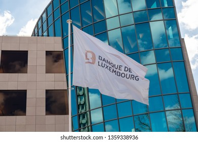 Luxembourg City / Luxembourg - 03 29 2019: Banque de Luxembourg flag in front of office building.