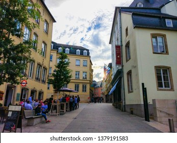 Luxembourg City, Luxembourg; 08/10/2018: Typical houses of Luxembourg in the center (centre, old town) of Luxembourg City, with people drinking in bars and walking on the streets