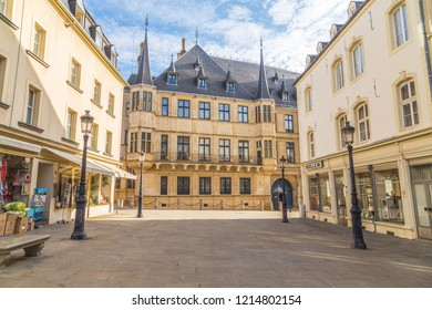 LUXEMBOURG CITY, LUXEMBOURG - 12TH OCTOBER 2018: A view of the Grand Ducal Palace during the day. Street lights, other buildings can be seen.