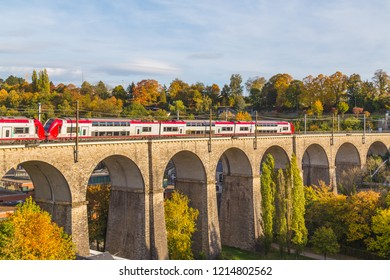 LUXEMBOURG CITY, LUXEMBOURG - 12TH OCTOBER 2018: Double Decker trains on a bridge in Luxembourg during the  day.