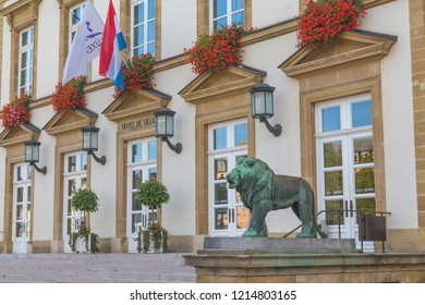 LUXEMBOURG CITY, LUXEMBOURG - 12TH OCTOBER 2018: The outside of the front Luxembourg Town Hall during the day. A statue of a lion can be seen outside the building.