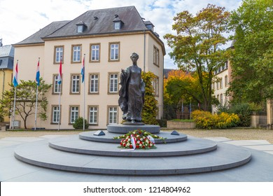 LUXEMBOURG CITY, LUXEMBOURG - 12TH OCTOBER 2018: The Grand Duchess Charlotte Monument located on Clairefontaine Square. Flowers can be seen at the base of the statue.