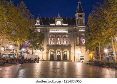 LUXEMBOURG CITY, LUXEMBOURG - 12TH OCTOBER 2018: The outside of the City Palace (Cercle Cite) at night. People can be seen.