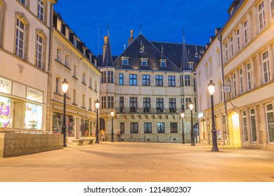 LUXEMBOURG CITY, LUXEMBOURG - 13TH OCTOBER 2018: A view of the Grand Ducal Palace at twlight. Street lights, other buildings and people can be seen.