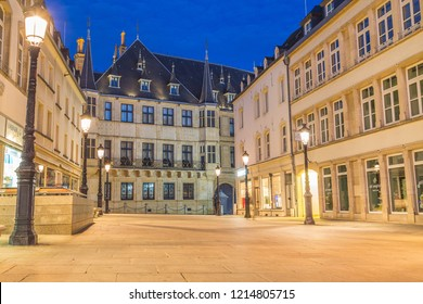 LUXEMBOURG CITY, LUXEMBOURG - 13TH OCTOBER 2018: A view of the Grand Ducal Palace at twlight. Street lights and other buildings can be seen.