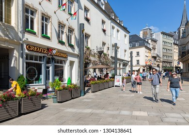 Luxembourg city, Luxembourg - August 18, 2018: Centre Luxembourg city with restaurants and shopping people